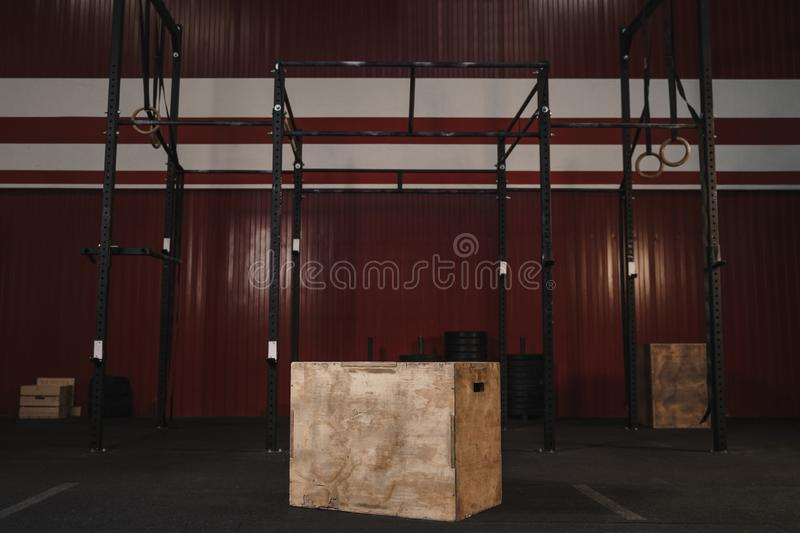 Crossfit gym with workout equipment. Box jumps horizontal bars, gymnastic rings, weights stock photography