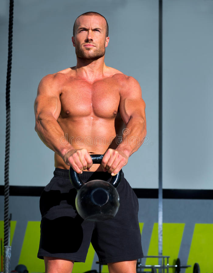 Crossfit Kettlebells swing exercise man workout royalty free stock photo