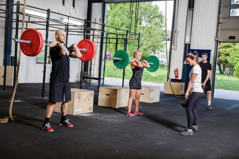 Crossfit training with weights and kettlebells royalty free stock photography