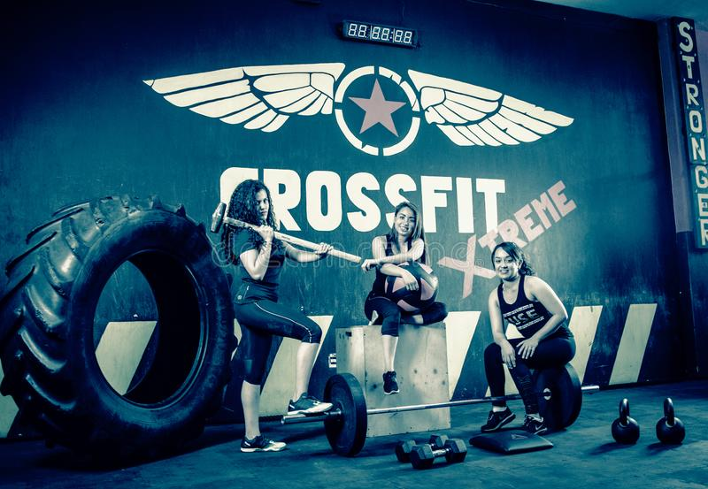 Crossfitters training hard daily wod posing royalty free stock images