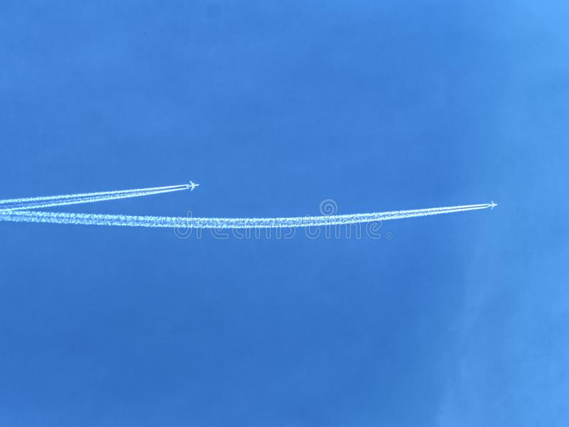 Crossing of airline lines on the blue sky royalty free stock photography