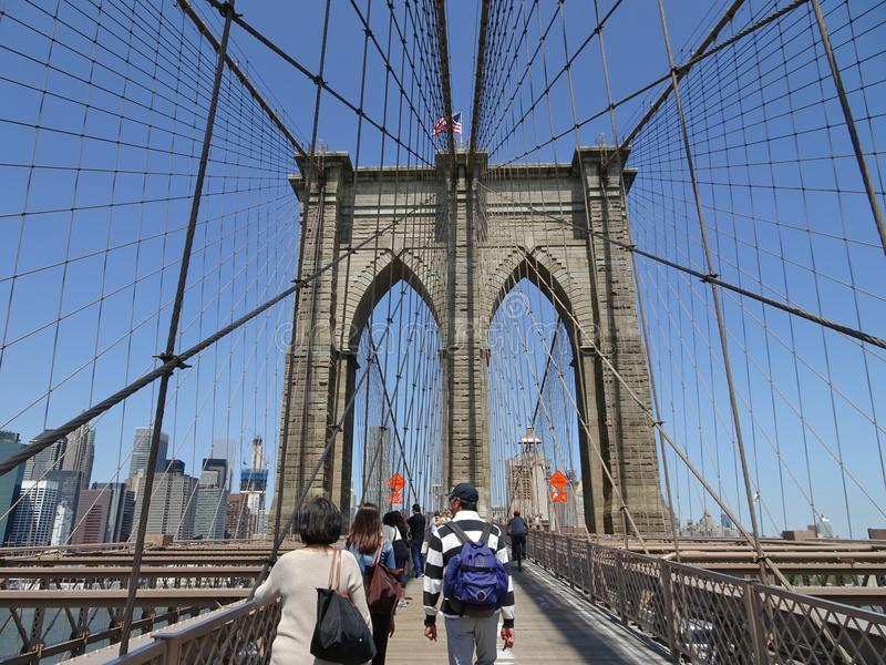 Crossing Brooklyn Bridge royalty free stock photography