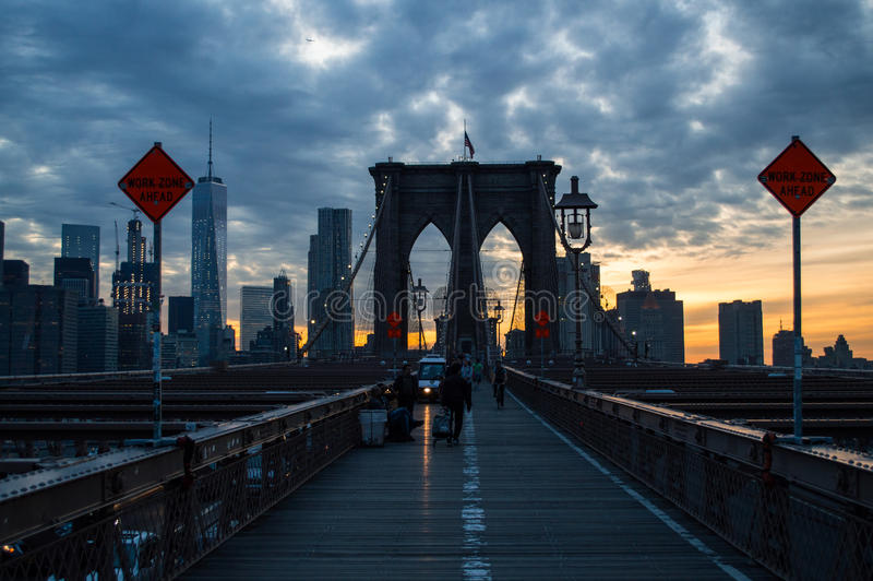 Crossing Brooklyn Bridge in Manhattan during Sunset stock photo