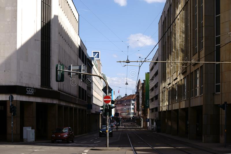 Crossing downtown Saarbruecken. Saarbruecken, Germany - July 29, 2018: A crossroads with traffic in the banking district of Saarbruecken at the Federal State royalty free stock image