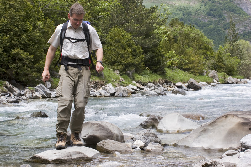 Crossing a mountain river royalty free stock photos