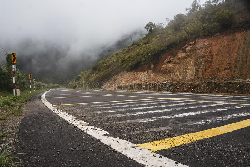 Crossing the mountains in a foggy road. To Đà Lạt royalty free stock image