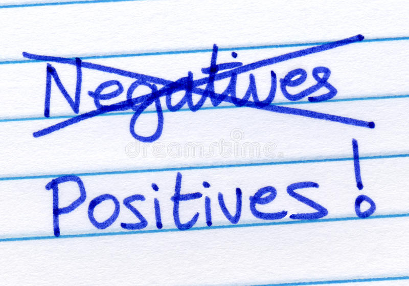 Crossing out negatives and writing positives. Crossing out negatives and writing positives on note paper stock photo