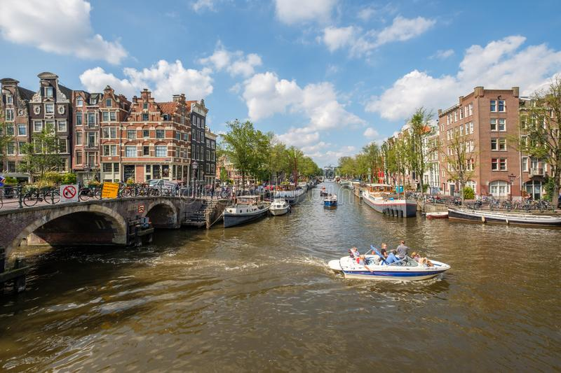 Crossing the Prinsengracht and Brouwersgracht in Amsterdam.on a beautiful day. Boats sail over the crossing of the Prinsengracht and Brouwersgracht in Amsterdam stock photos