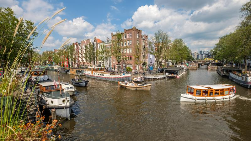 Crossing the Prinsengracht and Brouwersgracht in Amsterdam.on a beautiful day. Boats sail over the crossing of the Prinsengracht and Brouwersgracht in Amsterdam royalty free stock photography