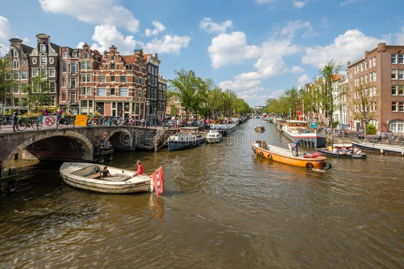 Crossing the Prinsengracht and Brouwersgracht in Amsterdam.on a beautiful day. Boats sail over the crossing of the Prinsengracht and Brouwersgracht in Amsterdam stock photo