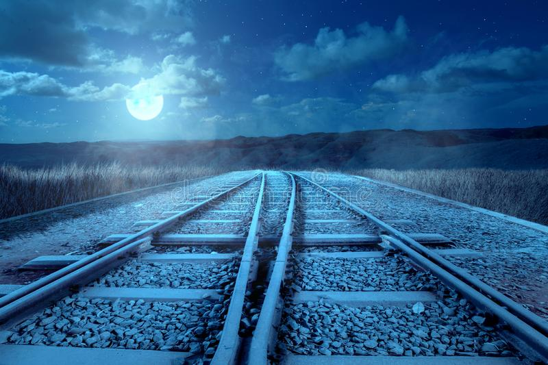 The crossing of a railroad track on the hills stock images
