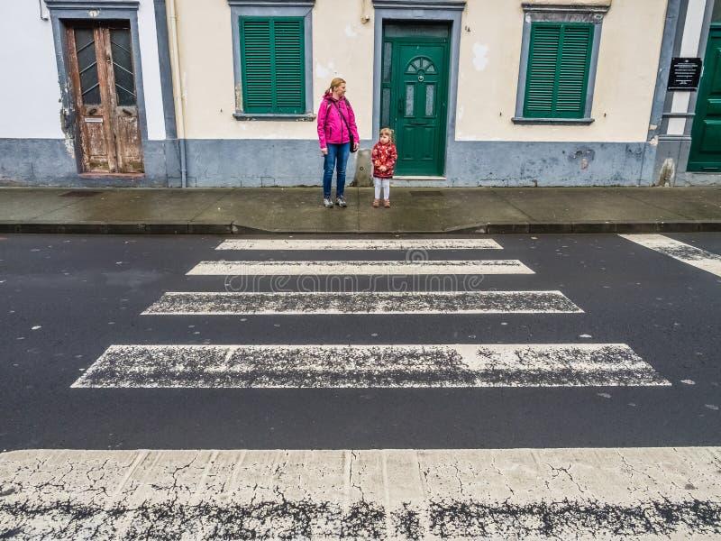 Crossing the road in Ponta Delgada royalty free stock image
