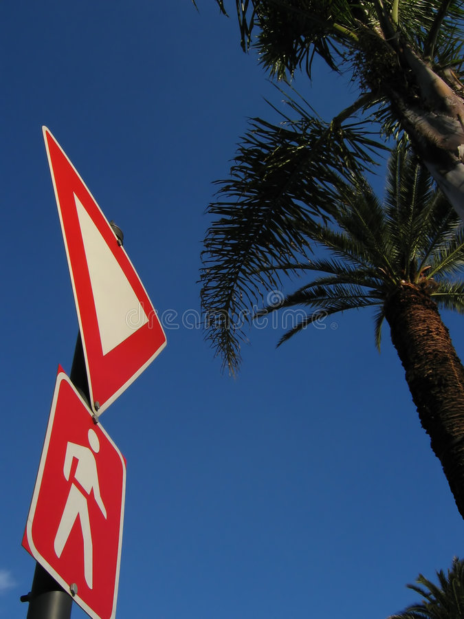 Download Crossing Sign And Palm Trees Stock Photo - Image: 24854