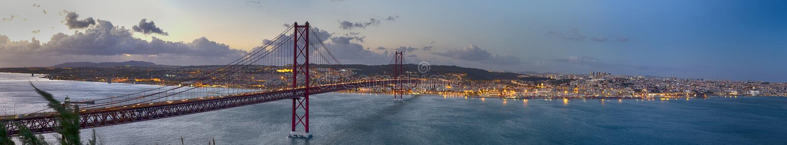 Crossing The Tagus River. Amazing Panoramic Image of Lisbon Cityscape Along with 25th April Bridge Ponte 25 de Abril. Taken from stock photos