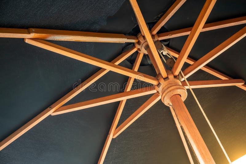 Crossing wooden umbrella structure create an abstract pattern on black royalty free stock photos