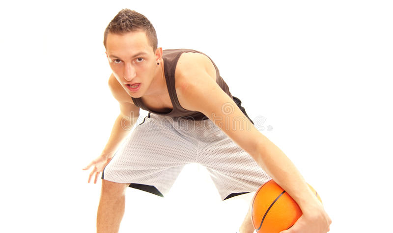 Crossover. A basketball player doing what he does best, a crossover stock photo