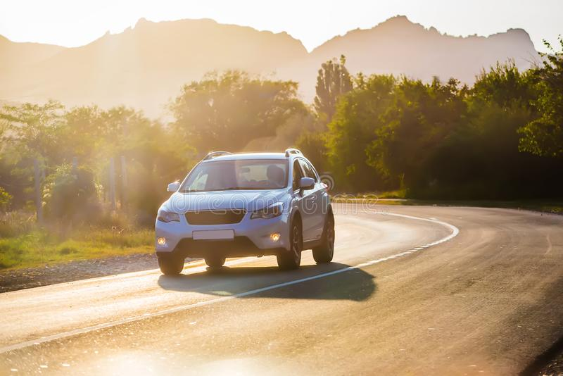 Crossover Rides the Highway. In a Beautiful Mountainous Area stock photo