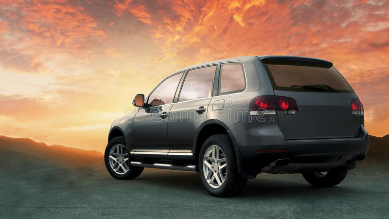 Crossover SUV in the hillside with sunset in the background. 5 door compact crossover SUV in the hillside with sunset in the background stock photo