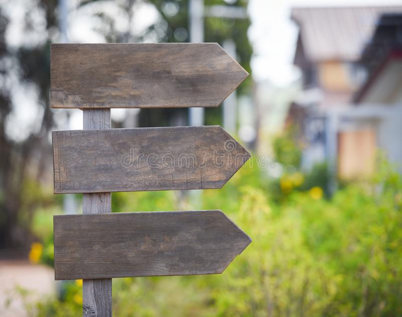Crossroad signpost arrow - wooden road sign empty in the way royalty free stock photo