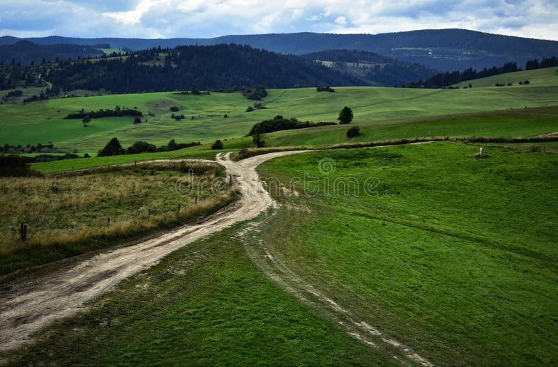 The crossroads of field roads in nature stock photography