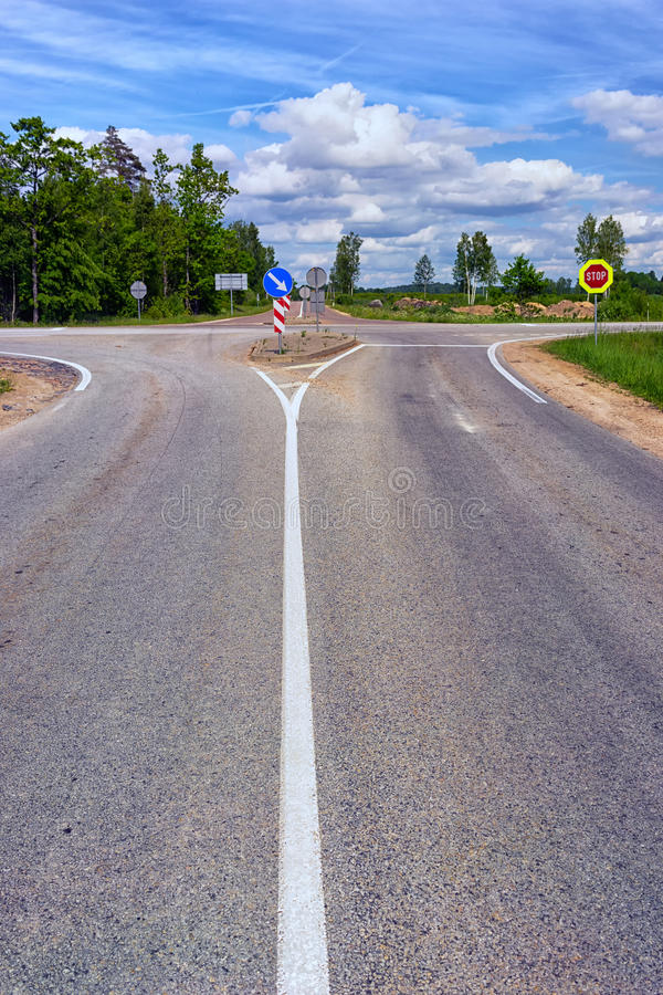 Crossroads on the highway in summer stock images