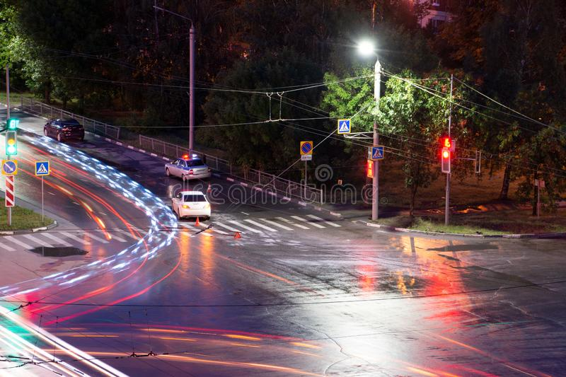 At the crossroads at night, the driver violated and knock down a pedestrian. The police draw up a road traffic accident. Police stock images