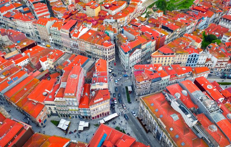 Crossroads or road junction in a European city, red roofs top view, portuguese houses and architecture royalty free stock image
