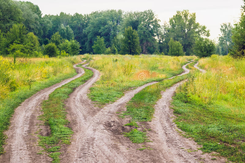 Crossroads, two different directions in the field stock photography