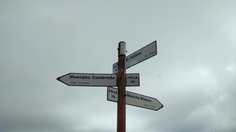 Crossroads. A way to the volcano stock photos