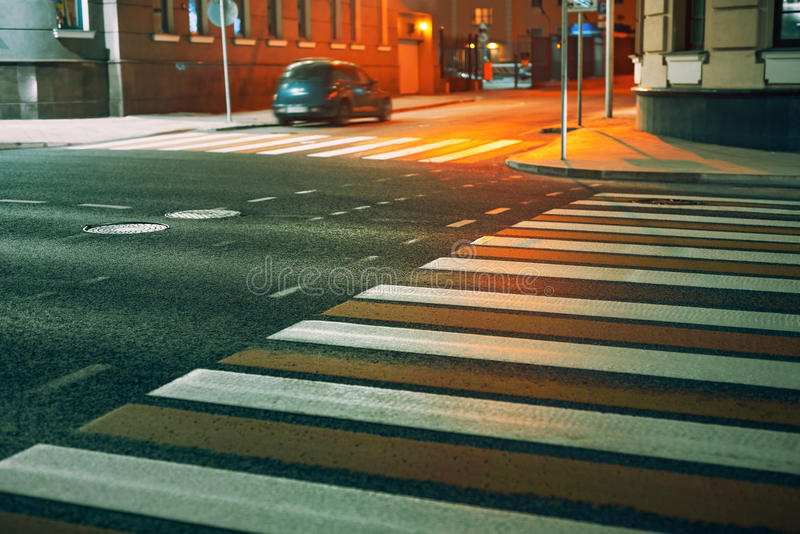 Crosswalk in city. At night. Pedestrian safety concept royalty free stock images