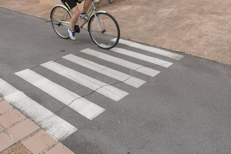 Crosswalk symbol with Cyclists In the park. stock images