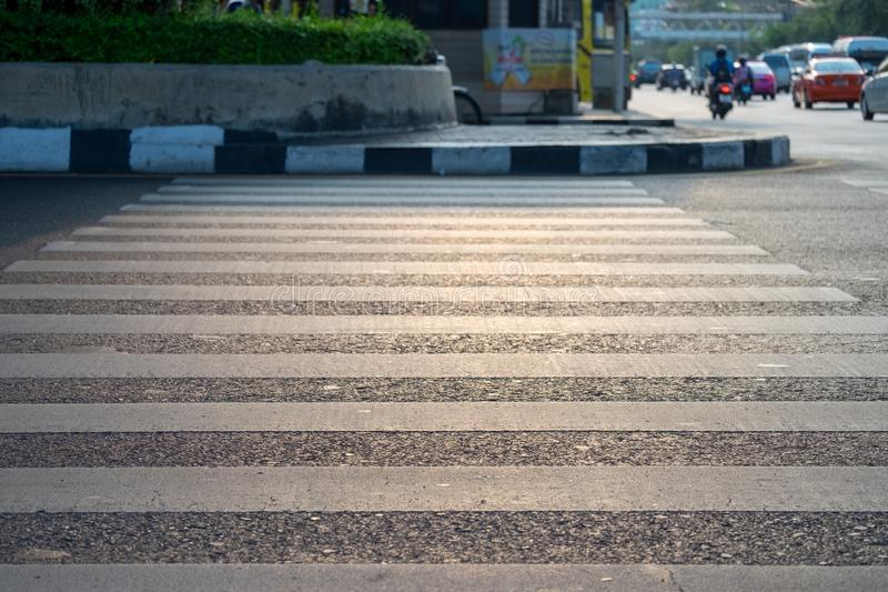 Crosswalk to cross the intersections with the background of cars royalty free stock photo