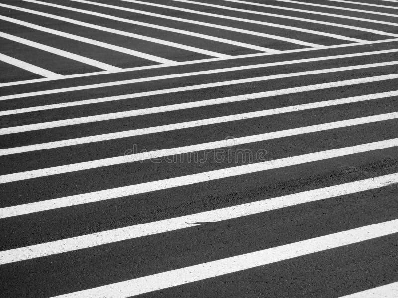 Crosswalk. A very large designated black and white striped pedestrian crosswalk area stock image