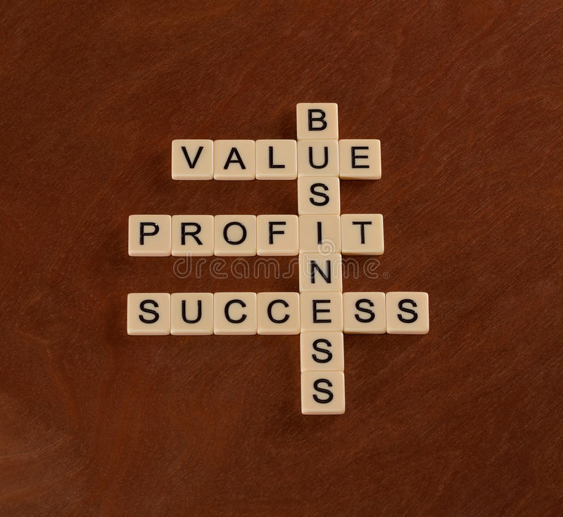 Crossword puzzle with words value, profit, business. Success in stock photos