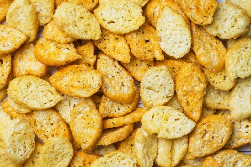 Crostini delle baguette del pane bianco con le spezie in piatti Fine in su fotografia stock libera da diritti