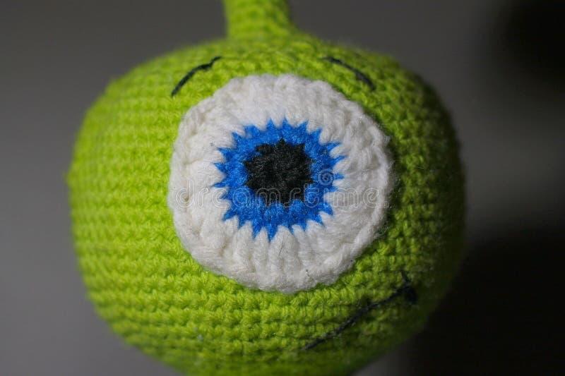 Crotchet alien toy. Child& x27;s stuffed toy royalty free stock photos