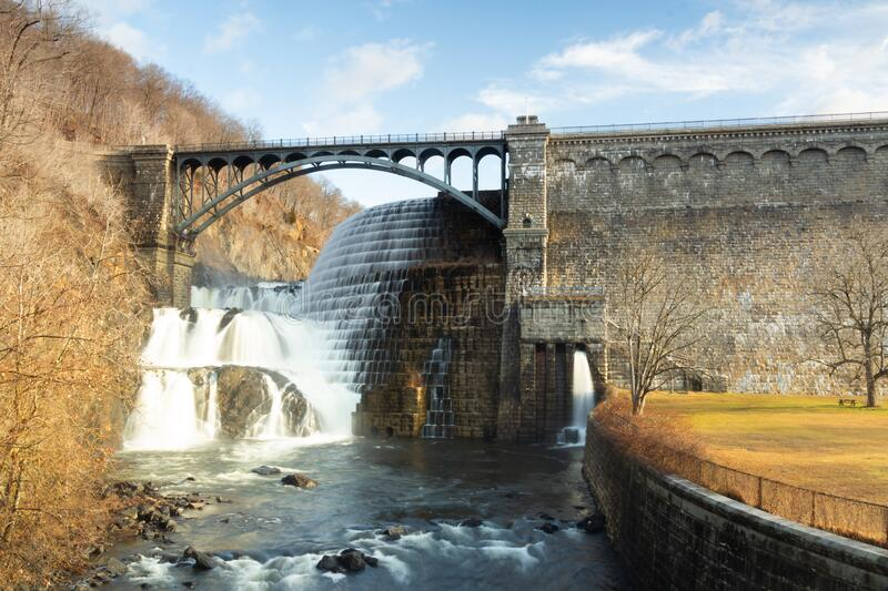 Croton-On-Hudson, NY / United States - Jan 12, 2020: sunrise view of the New Croton Dam, spillway and reservioir from below the. Horizontal view of the dam stock images
