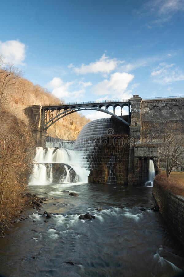 Croton-On-Hudson, NY / United States - Jan 12, 2020: sunrise view of the New Croton Dam, spillway and reservioir from below the. Vertical sunrise view of the New royalty free stock photo
