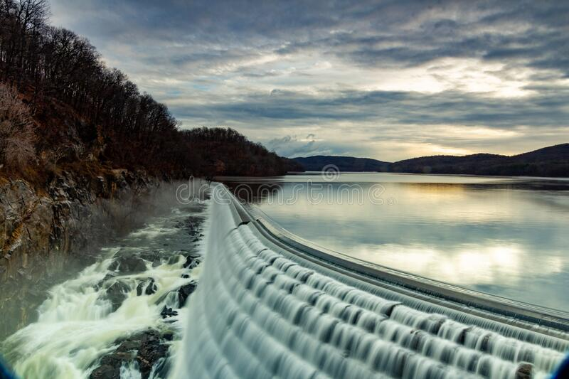 Croton-On-Hudson, NY / United States - Jan 12, 2020: sunrise view of the New Croton Dam, spillway and reservioir from the iron. Sunrise horizontal image of the royalty free stock photos