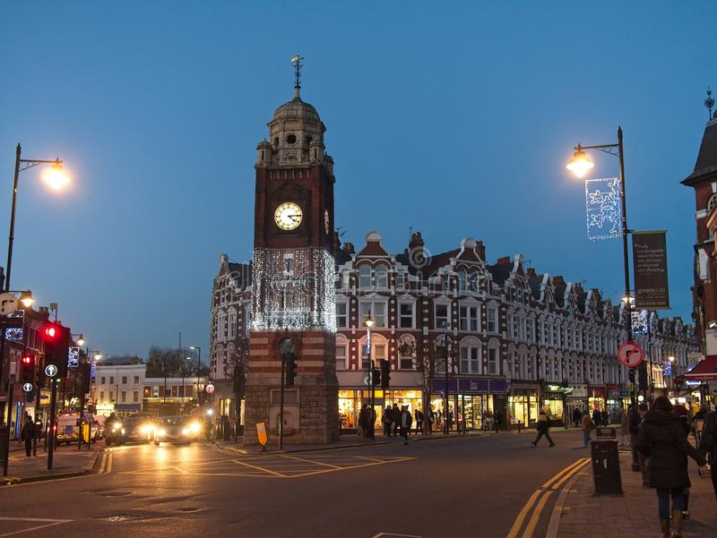 Crouch End Broadway and clocktower with Christmas decoration and lights in the evening. stock image
