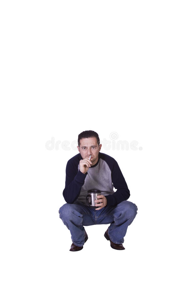 Crouched Man Smoking And Drinking Coffee Royalty Free Stock Images