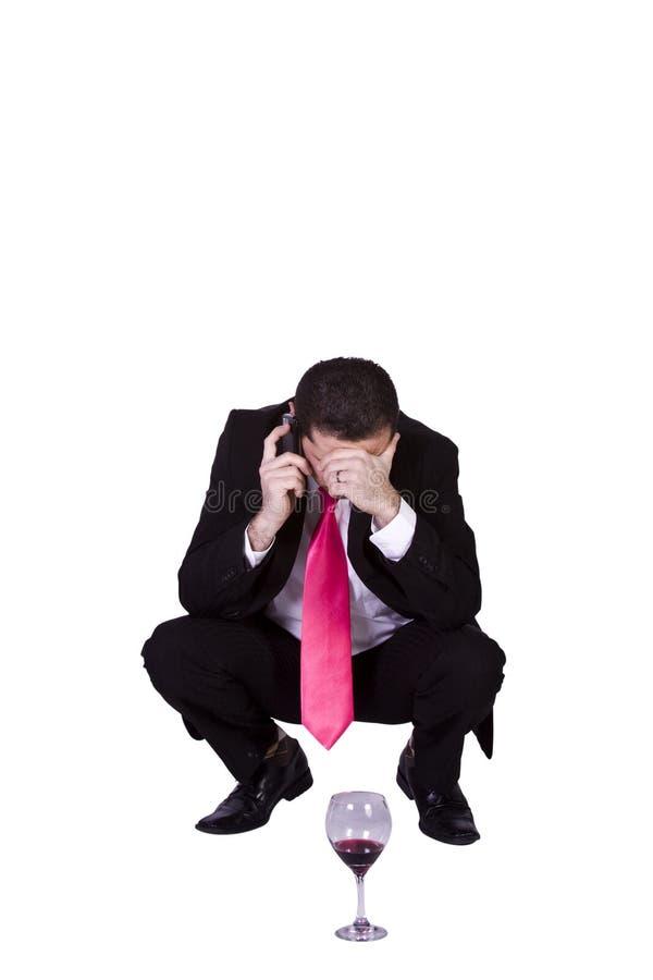 Crouched Mediterranean Man Drinking Stock Photos