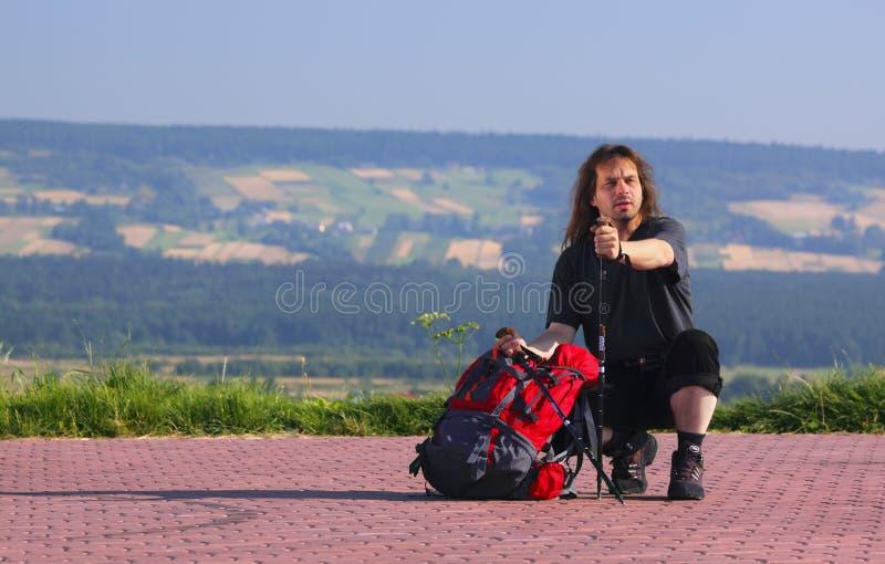 Crouching tourist royalty free stock photo