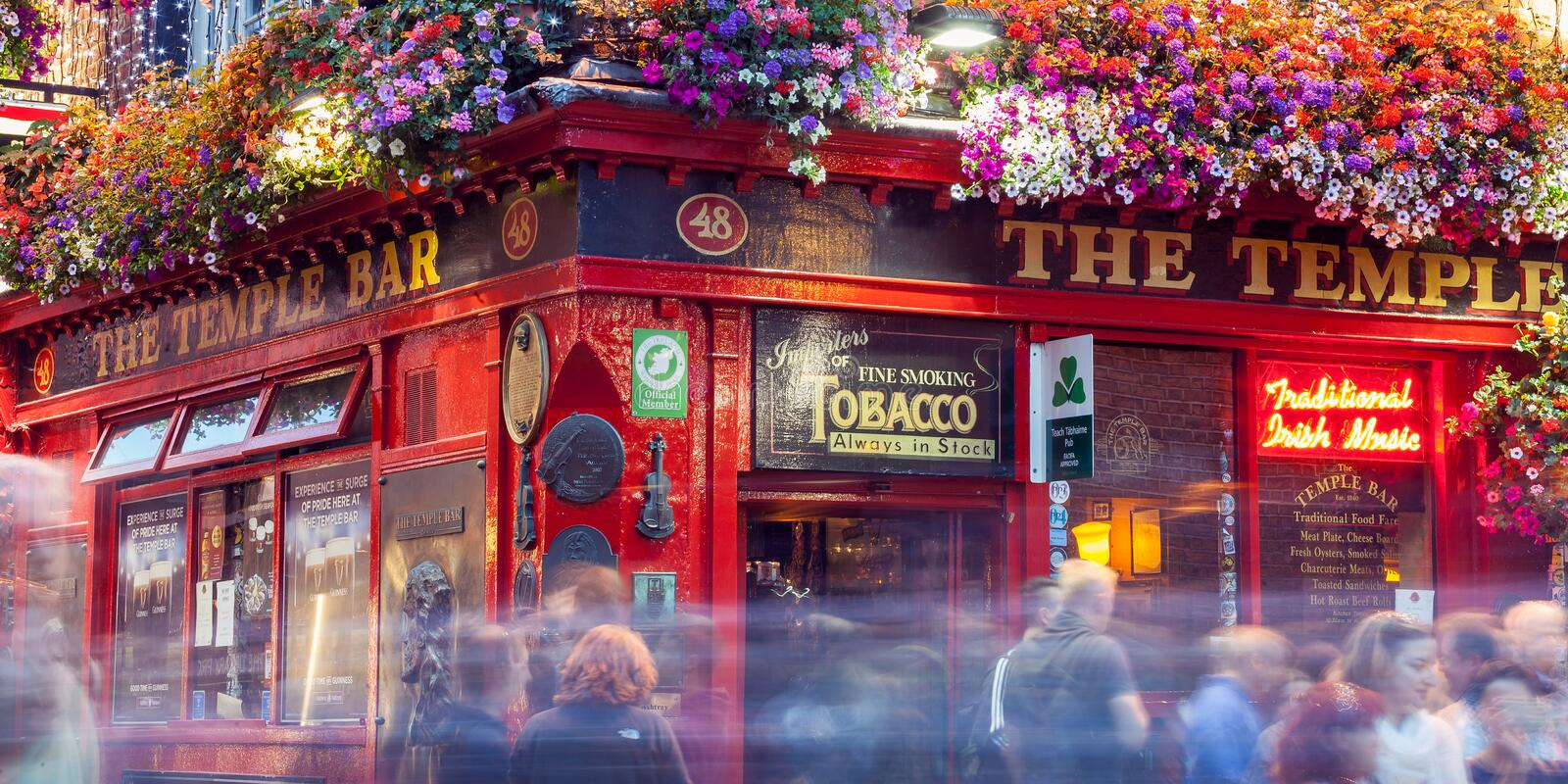 Croud of people at the Temple Bar. Dublin, Ireland - 05 July 2018: Croud of people at the Temple Bar, a traditional pub in the Temple Bar entertainment district royalty free stock photo