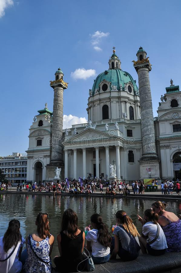 Croud of Tourists at the Karlskirche, St. Charles church in the center of Vienna. The church was consecrated in 1737 and dedicated to Saint Charles Borromeo royalty free stock photography