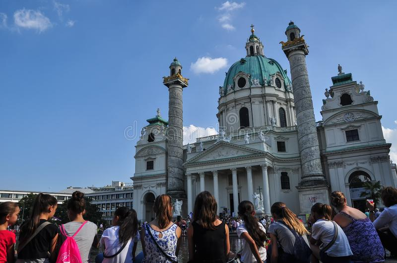 Croud of Tourists at the Karlskirche, St. Charles church in the center of Vienna. The church was consecrated in 1737 and dedicated to Saint Charles Borromeo royalty free stock images