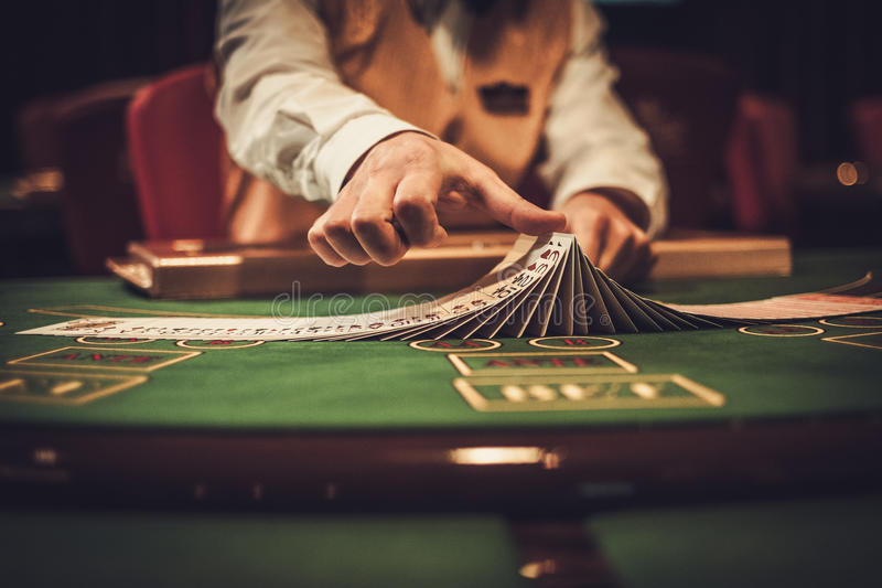 Croupier behind gambling table in a casino stock photos