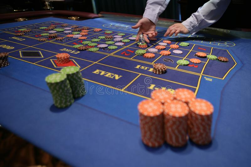 Croupier behind gambling table in a casino royalty free stock photos