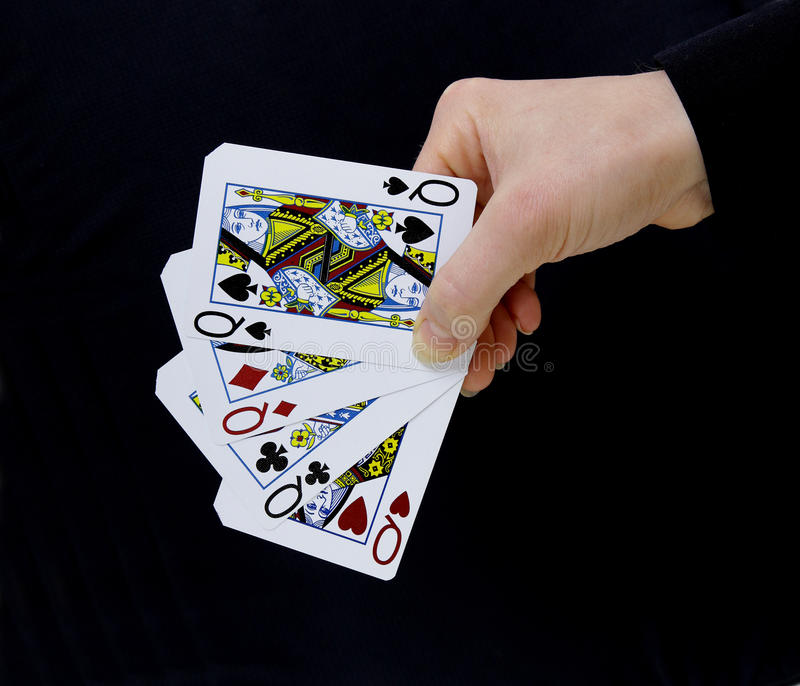 Croupier player holding card queens four of a kind stock image