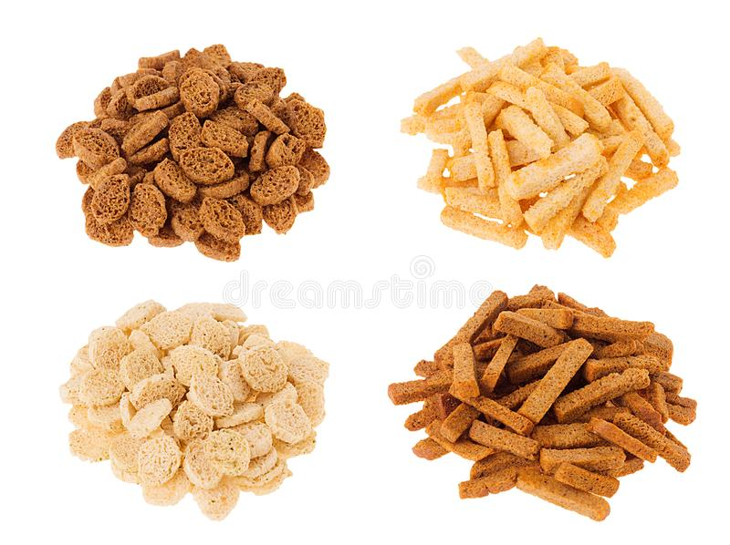 Croutons collection - wheat, rye sliced bread in heaps isolated on white background. royalty free stock photography